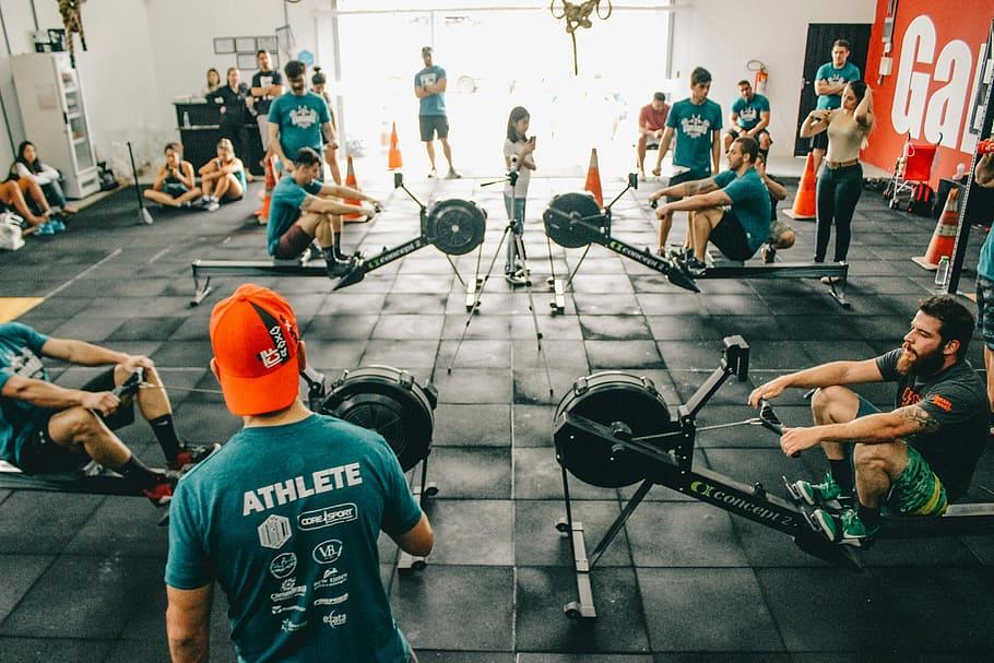 row machine exercises everyone participating